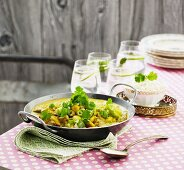 Chicken curry with spring onions, chickpeas and coriander
