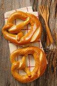 Two pretzels on a tea towel
