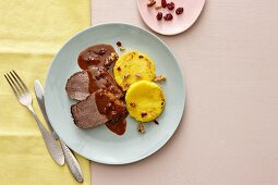 Roast beef with cranberry sauce, polenta and caramelised walnuts