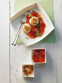 Quark dumplings with coconut crumbs with raspberry and strawberry compote