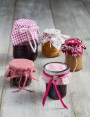 Colourful fabric lid covers for jars of preserves as gifts