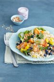 Fruity quinoa salad with blueberries, apricot and yellow peppers