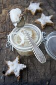 Goose dripping in a glass jar with bread stars and onion rings