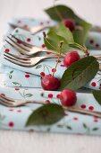 Cherries, napkins and cake forks