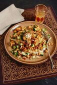 Bread salad with chickpeas, cucumber and pine nuts (Arabia)