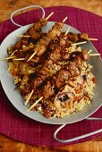 Lamb skewers on a bed of couscous with dried fruit and pine nuts (Arabia)