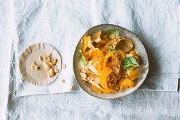 Raw pumpkin salad with peanuts