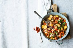 Fried Spanish potatoes with peppers and chilli peppers
