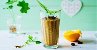 A smoothie made with cranberries, apples, oranges and spring herbs