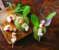 Peach and banana smoothie with cos lettuce, rocket and dandelions