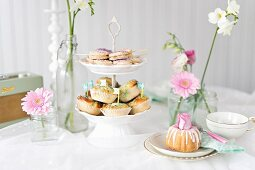 A romantic buffet with biscuit lollies, buns and a mini Bundt cake