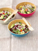 Rice salad with kidney beans, avocado, rocket and chilli