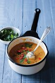 Tomato and lentil soup with black caraway seeds