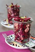 Beetroot salad with veal and chives in glasses
