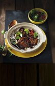 Braised oxtails with rice wine, chilli and coriander