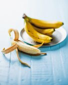 An arrangement of banana with one half peeled