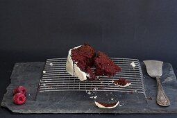 A slice of Red Velvet cake on a wire rack