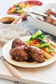 Chicken with a honey and soy glaze serve with oriental vegetables