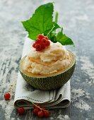 Melon ice cream with redcurrants