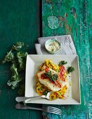 Green kale and pumpkin mash with cod and horseradish sour cream