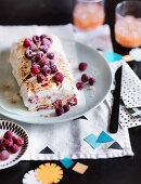 Sesame praline meringue roulade with rosewater raspberries
