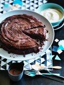 Chocolate, prune and walnut cake with chocolate and Sherry ganache