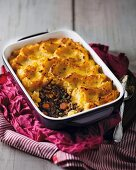 Ostrich pie with a pumpkin and potato topping