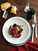 Roast duck with boudin noir and pickled rhubarb