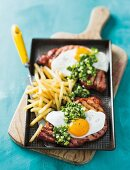 Gammon steaks with fried eggs and chips