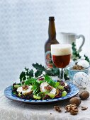 Winter salad with cheese and walnut crostini and grapes