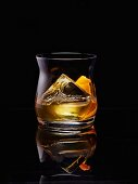 Whiskey on the rocks with orange zest