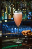 A Bellini served with cheese pastries