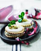Savoury shortcrust tartlets with cream cheese and gherkins