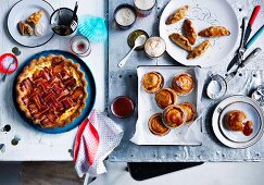 Bacon and tomato polenta pie, Spiced pasties with lime pickle yoghurt, Party pies with homemade tomato sauce