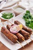 Seekh kebab with onion and lemon (meat skewers, India)