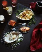A fish platter with oysters on samphire, fish with Mornay sauce, fried prawns and crispy, skinned fish