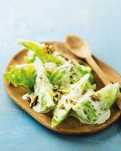 Iceberg lettuce wedges with a blue cheese dressing and roasted walnuts
