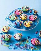Colourful fish cupcakes decorated with butter cream and chocolate beans