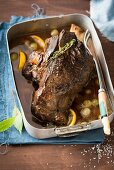 Leg of venison with grapes and lemons