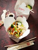Oriental noodles with vegetables in a box