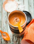 Carrot soup in an insulated container
