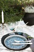 A winter table laid outside in shades of white and grey
