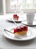 Two slices of raspberry sponge cake