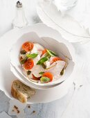 Chicken vitello with tomatoes, basil and capers for Easter