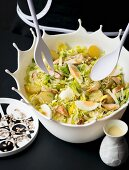 Party salad with hard-boiled eggs, potatoes and turkey breast
