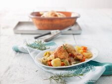 Roast chicken in a terracotta baking dish