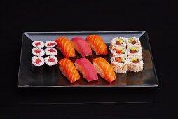 A sushi platter with maki and nigiri