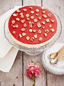 Cheesecake with strawberry glaze and hazelnuts