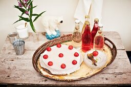 An ice cream cake with strawberries and meringue