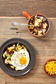 Potato salad with kidney beans, sweetcorn, avocado and fried egg